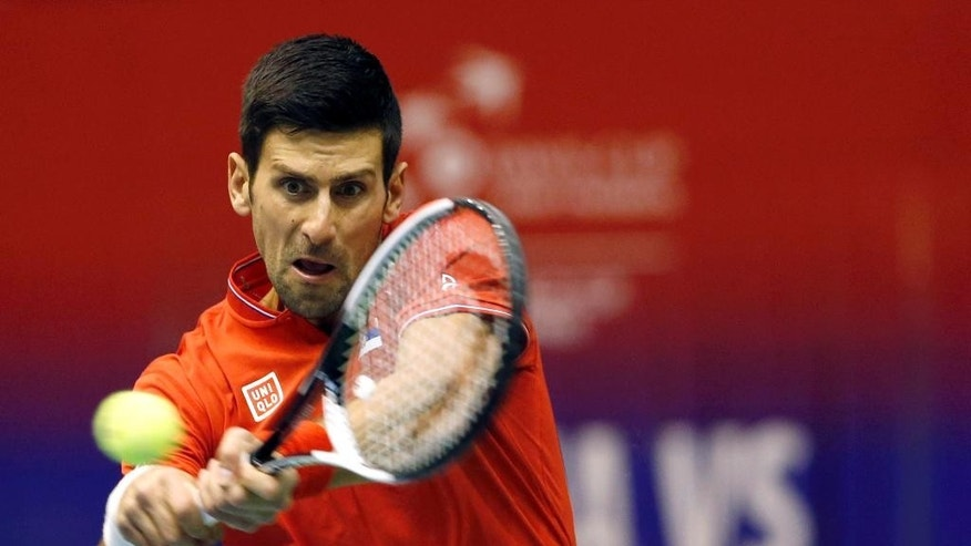 "FILE - In this April 7, 2017 file photo, Serbia's Novak Djokovic returns the ball to Spain's Albert Ramos-Vinolas during their Davis Cup quarterfinal tennis match, in Belgrade, Serbia. Djokovic has split with his longtime coach Marian Vajda and two other team members, saying he wants to find ""the winning spark on the court again."" Djokovic said on his website on Friday, May 5 that he ""mutually agreed"" with Vajda, fitness coach Gebhard Phil Gritsch, and physiotherapist Miljan Amanovic to end their ""successful and long term partnership"" two weeks ago after the Monte Carlo Masters, where he lost in quarterfinals.  (AP Photo/Darko Vojinovic, File)"