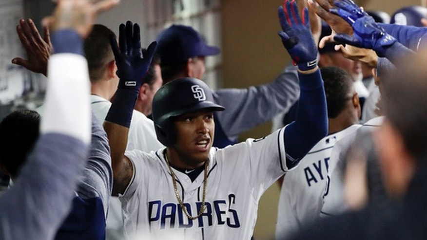 San Diego Padres' Yangervis Solarte is greeted by teammates in the dugout after his two-run home run during the sixth inning of a baseball game against the Colorado Rockies on Tuesday, May 2, 2017, in San Diego. (AP Photo/Gregory Bull)
