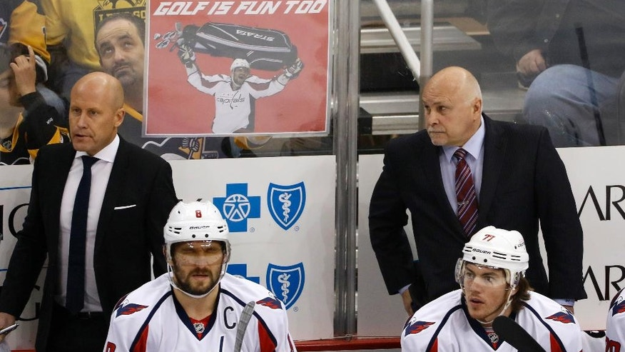 Washington Capitals' Alex Ovechkin (8) and T.J. Oshie (77) sit on the bench in front of assistant coach Blaine Forsythe, left, and coach Barry Trotz during the first period of Game 4 in an NHL hockey Stanley Cup Eastern Conference semifinal against the Pittsburgh Penguins in Pittsburgh, Wednesday, May 3, 2017. The Penguins won 3-2. (AP Photo/Gene J. Puskar)