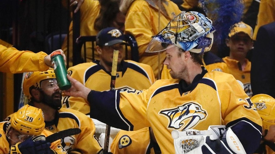 Nashville Predators goalie Pekka Rinne, of Finland, gets a new water bottle during the second period in Game 6 of a second-round NHL hockey playoff series against the St. Louis Blues, Sunday, May 7, 2017, in Nashville, Tenn. (AP Photo/Mark Humphrey)