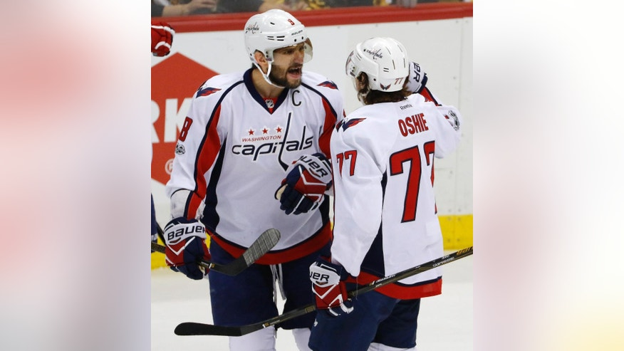 Washington Capitals' T.J. Oshie (77) celebrates his goal with Alex Ovechkin in the first period of Game 6 in an NHL Stanley Cup Eastern Conference semifinal hockey game against the Pittsburgh Penguins in Pittsburgh, Monday, May 8, 2017. (AP Photo/Gene J. Puskar)