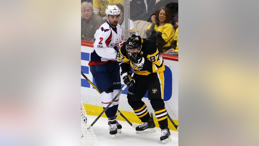 Pittsburgh Penguins' Sidney Crosby (87) holds his face after colliding with Washington Capitals' Matt Niskanen (2) during the first period of Game 6 in an NHL Stanley Cup Eastern Conference semifinal hockey game in Pittsburgh, Monday, May 8, 2017. Crosby remained in the game. (AP Photo/Gene J. Puskar)