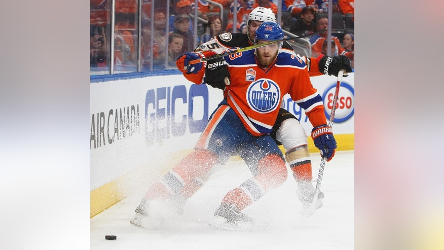 Anaheim Ducks' Sami Vatanen (45) and Edmonton Oilers' Leon Draisaitl (29) battle for the puck during the second period in Game 6 of a second-round NHL hockey playoff series in Edmonton, Alberta, Sunday, May 7, 2017. (Jason Franson/The Canadian Press via AP)