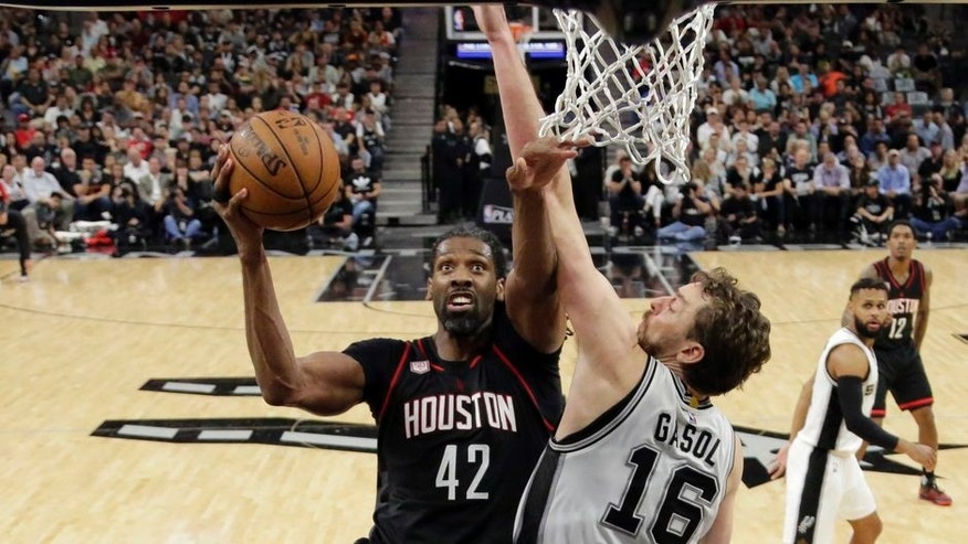 Houston Rockets center Nene Hilario (42) goes up for a shot as San Antonio Spurs' Pau Gasol (16) of Spain defends during the second half of Game 2 in a second-round NBA playoff series basketball game, Wednesday, May 3, 2017, in San Antonio. (AP Photo/Eric Gay)