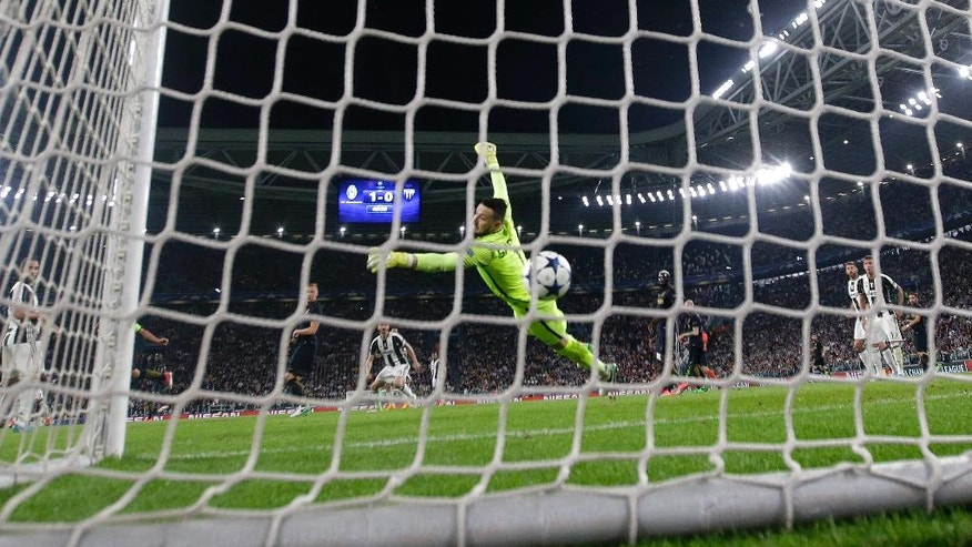 Juventus&#x27 Dani Alves scores his side's second goal during the Champions League semi final second leg soccer match between Juventus and Monaco in Turin Italy Tuesday