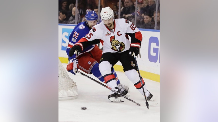New York Rangers' Rick Nash (61) fights for control of the puck with Ottawa Senators' Erik Karlsson (65) during the second period of Game 6 of an NHL hockey Stanley Cup second-round playoff series Tuesday, May 9, 2017, in New York. (AP Photo/Frank Franklin II)