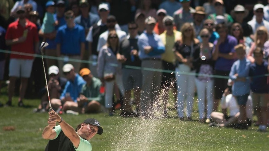 Phil Mickelson hits from the sand on the 2nd hole during the final round of the Wells Fargo Championship golf tournament at Eagle Point Golf Club in Wilmington, N.C., Sunday, May 7, 2017. (AP Photo/Mike Spencer)