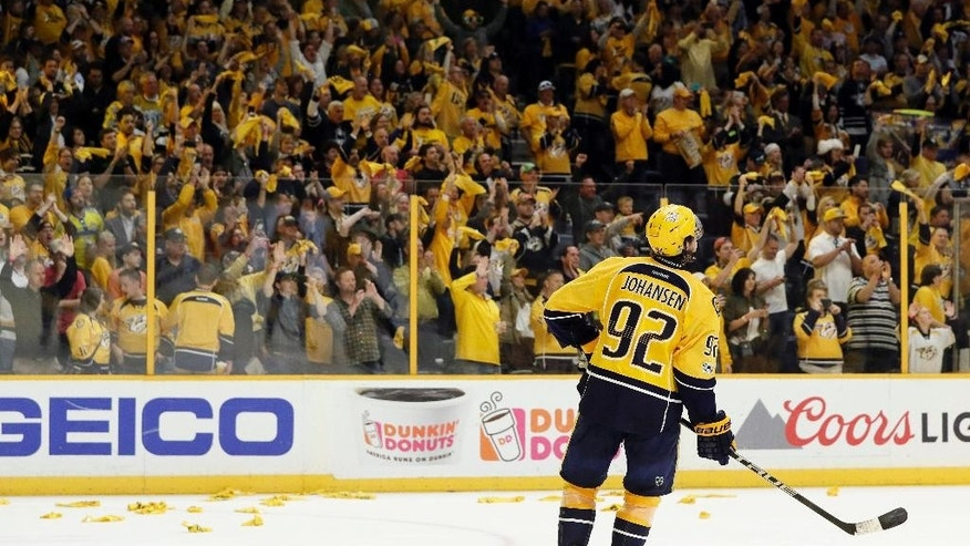 Nashville Predators center Ryan Johansen watches as fans celebrate following the Predators' win over the St. Louis Blues in Game 6 of a second-round NHL hockey playoff series Sunday, May 7, 2017, in Nashville, Tenn. Johansen had the winning goal in the third period as the Predators won 3-1 to win the series 4-2. (AP Photo/Mark Humphrey)