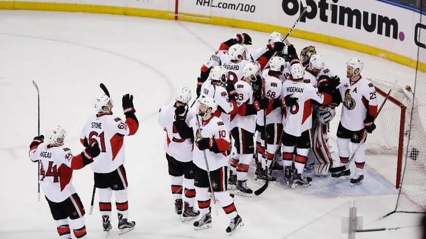 The Ottawa Senators celebrate after Game 6 of an NHL hockey Stanley Cup second-round playoff series against the New York Rangers, Tuesday, May 9, 2017, in New York. The Senators won 4-2. (AP Photo/Frank Franklin II)