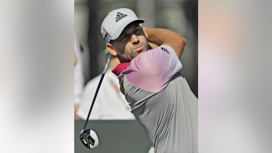 Sergio Garcia, of Spain watches his tee shot on the 10th hole during a practice round for The Players Championship golf tournament, Wednesday, May 10, 2017, in Ponte Vedra Beach, Fla. (AP Photo/Chris O'Meara)