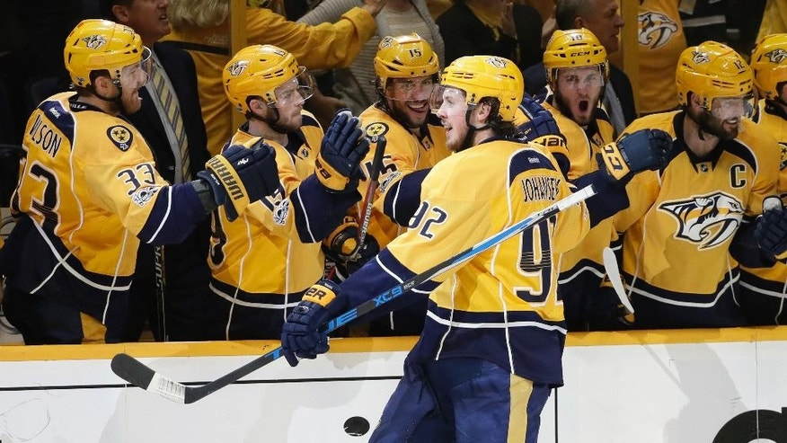 In this May 7, 2017, photo, Nashville Predators center Ryan Johansen (92) celebrates after scoring the winning goal against the St. Louis Blues during the third period in Game 6 of a second-round NHL hockey playoff series in Nashville, Tenn. Johansen is the big center the Predators brought in with their first big trade of 2016, lost in all the attention focused on the acquisition of defenseman P.K. Subban. Johansen has been a key piece in Nashville's run to the franchise's first ever berth in the Western Conference finals. (AP Photo/Mark Humphrey)