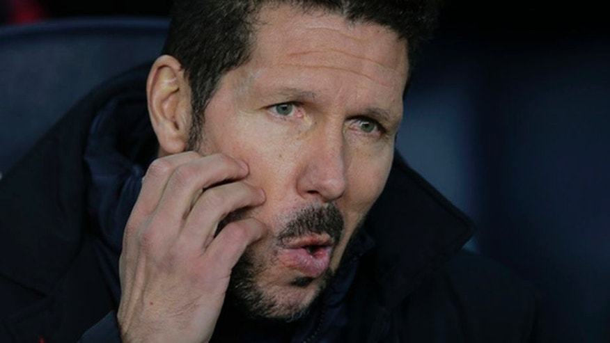Atletico's coach Diego Simeone sites on the bench before the the Copa del Rey semifinal second leg soccer match between FC Barcelona and Atletico Madrid at the Camp Nou stadium in Barcelona, Spain, Tuesday Feb. 7, 2017. (AP Photo/Manu Fernandez)