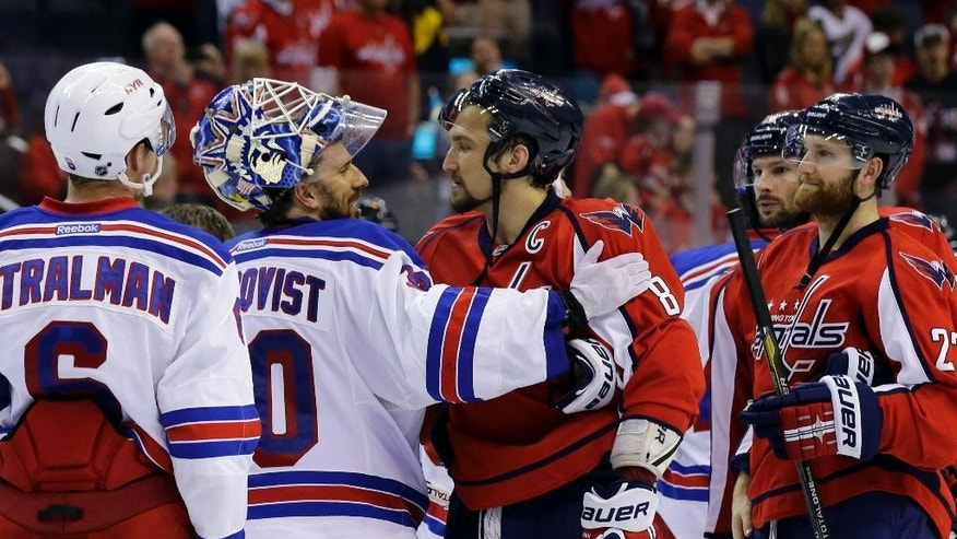 FILE - In this May 13, 2013, file photo, New York Rangers goalie Henrik Lundqvist (30), from Sweden, greets Washington Capitals left wing Alex Ovechkin (8), from Russia, after Game 7 of a first-round NHL hockey Stanley Cup playoff hockey series in Washington. The Rangers won 5-0. The Capitals face the Pittsburgh Penguins in Game 7 of a second-round series Wednesday, May 10. (AP Photo/Alex Brandon, File)