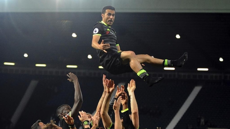 Chelsea's players throw Chelsea's Pedro in the air to celebrate after the English Premier League soccer match between West Bromwich Albion and Chelsea, at the Hawthorns in West Bromwich, England, Friday, May 12, 2017. Chelsea won the match 0-1 meaning they win the Premier League title. (AP Photo/Rui Vieira)
