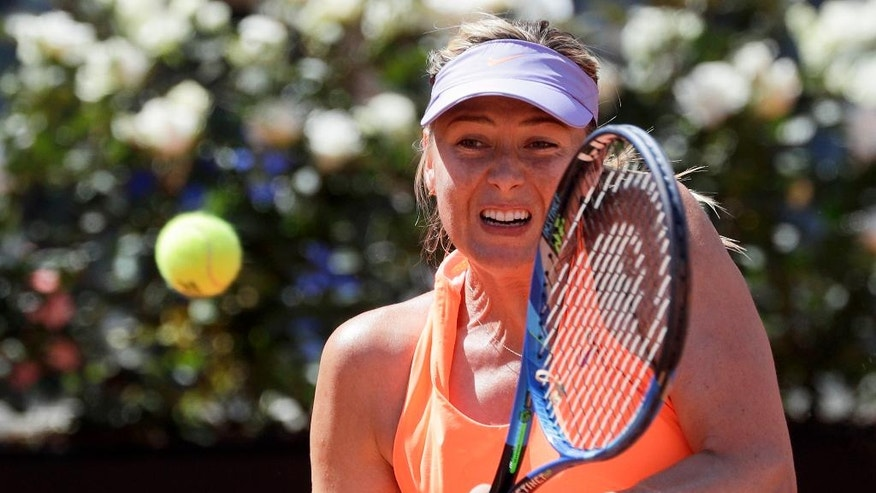 Maria Sharapova, of Russia, returns the ball to Christina Mchale, of the United States, during the Italian Open tennis tournament, in Rome, Monday, May 15, 2017. (AP Photo/Andrew Medichini)