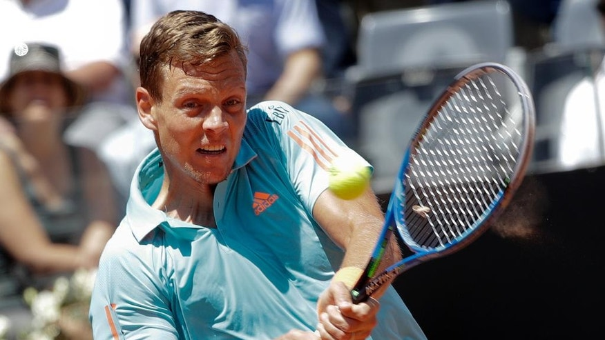Tomas Berdych of the Czech Republic returns the ball to Misha Zverev of Germany during the Italian Open tennis tournament, in Rome, Monday, May 15, 2017. (AP Photo/Andrew Medichini)