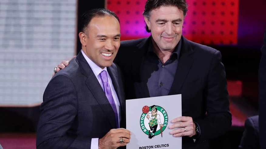 NBA Deputy Commissioner Mark Tatum, left, poses for photographs with Boston Celtics co-owner Wyc Grousbeck, right, after the Celtics won the first pick in the NBA basketball draft, at the draft lottery Tuesday, May 16, 2017, in New York. (AP Photo/Frank Franklin II)