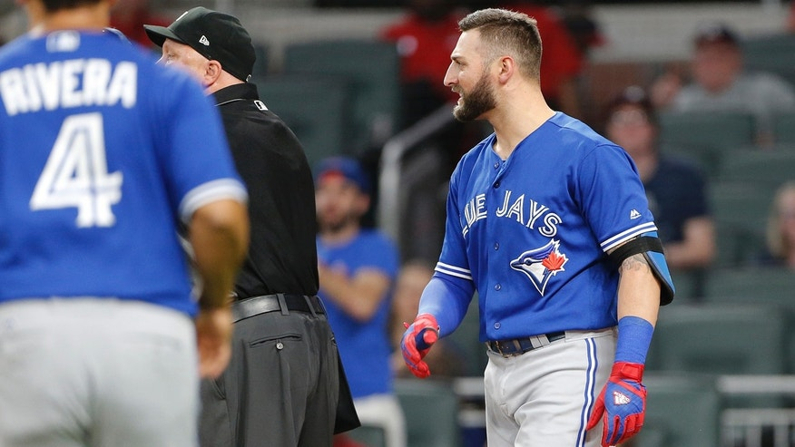 In this photo taken Wednesday, May, 17, 2017, Toronto Blue Jays Kevin Pillar (11) looks on as both benches empty onto the field after he exchanged words with Atlanta Braves relief pitcher Jason Motte (30) in the seventh inning of a baseball game , in Atlanta. Pillar has been suspended two games for yelling an anti-gay slur at a Braves pitcher. (AP Photo/John Bazemore)