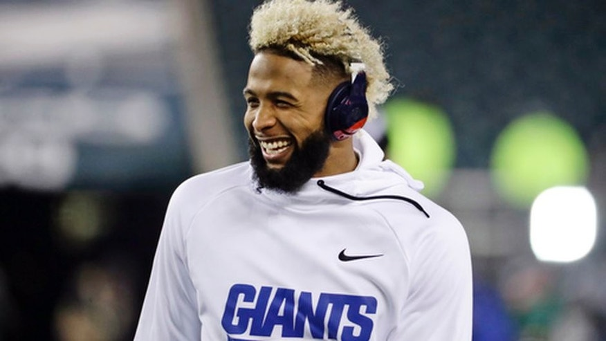 In this Dec. 22, 2016 photo, New York Giants' Odell Beckham smiles before an NFL football game against the Philadelphia Eagles in Philadelphia. The Giants have picked up the fifth-year option on Beckham Jr.'s contract, the team announced Thursday, April 27, 2017. (AP Photo/Michael Perez, File)