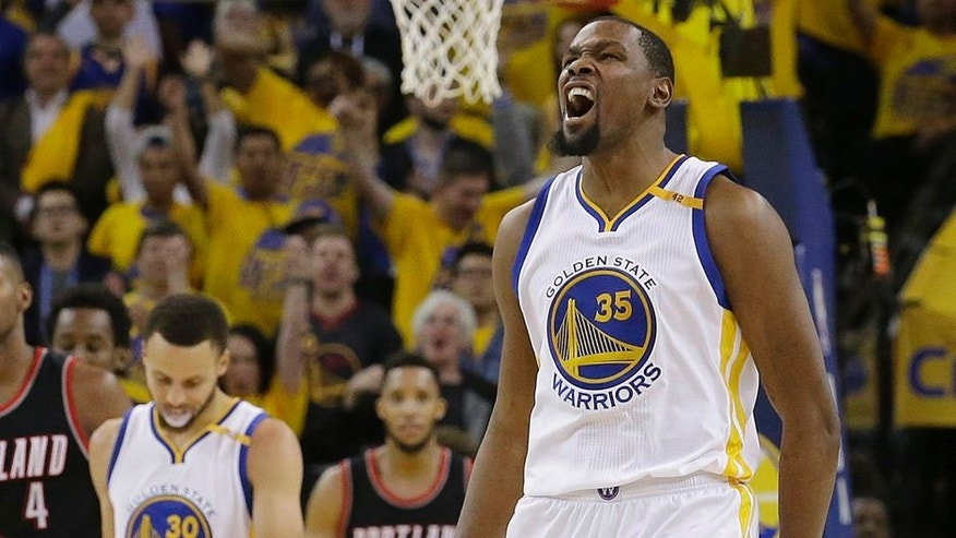 Golden State Warriors forward Kevin Durant (35) reacts after scoring against the Portland Trail Blazers during the second half of Game 1 of a first-round NBA basketball playoff series in Oakland, Calif., Sunday, April 16, 2017. The Warriors won 121-109. (AP Photo/Jeff Chiu)