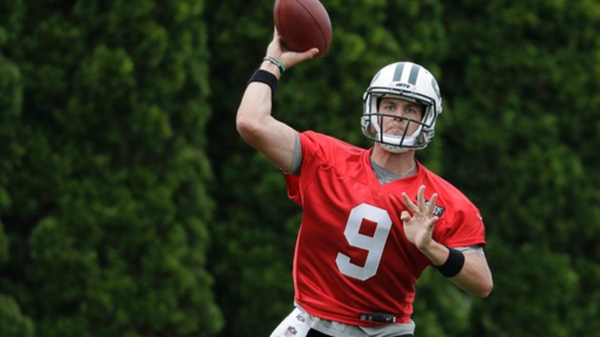 In this Tuesday, May 23, 2017, photo, New York Jets' Bryce Petty throws a pass during the team's organized team activities at its NFL football training facility in Florham Park, N.J. Petty is in the middle of a three-way quarterback competition that many believe is truly just a two-man race. And, he's the odd-man out. (AP Photo/Julio Cortez)