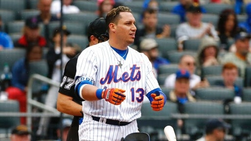 The New York Mets' Asdrubal Cabrera tosses his helmet and bat after home plate umpire Jim Reynolds called him out on strikes during the fifth inning against the Pittsburgh Pirates.