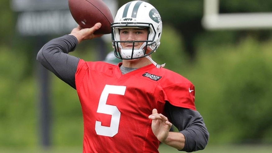 FILE - In this May 23, 2017, file photo, New York Jets' Christian Hackenberg throws a pass during the team's organized team activities at its NFL football training facility in Florham Park, N.J. The Jets would like to see Hackenberg take charge in the team's quarterback competition. But with the 2016 second-round draft pick out of Penn State still considered a project after not playing at all last season, it remains uncertain whether Hackenberg will progress enough to be the starter this year. (AP Photo/Julio Cortez, File)
