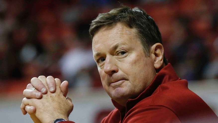Oklahoma football coach Bob Stoops is pictured during an NCAA college basketball game between Iowa State and Oklahoma in Norman, Okla., Saturday, Jan. 21, 2017. (AP Photo/Sue Ogrocki)