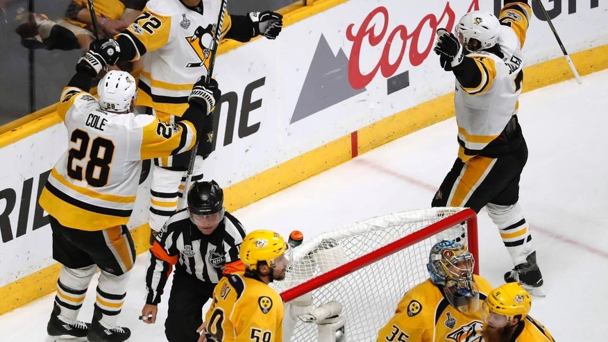 Pittsburgh Penguins' Patric Hornqvist (72), of Sweden,celebrates with Ian Cole (28) after scoring a goal against the Nashville Predators during the third period of Game 6 of the NHL hockey Stanley Cup Final, Sunday, June 11, 2017, in Nashville, Tenn.