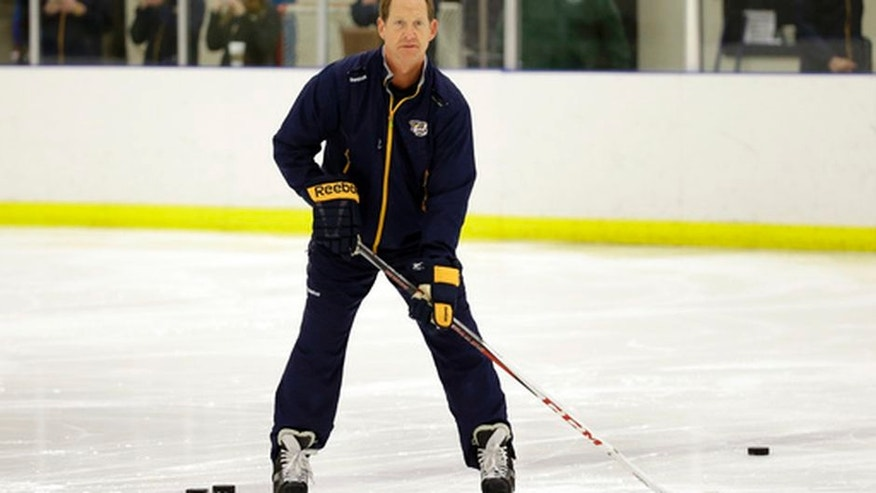 Nashville Predators assistant coach Phil Housley watches players at NHL hockey training camp Friday, Sept. 18, 2015, in Nashville, Tenn. (AP Photo/Mark Humphrey)