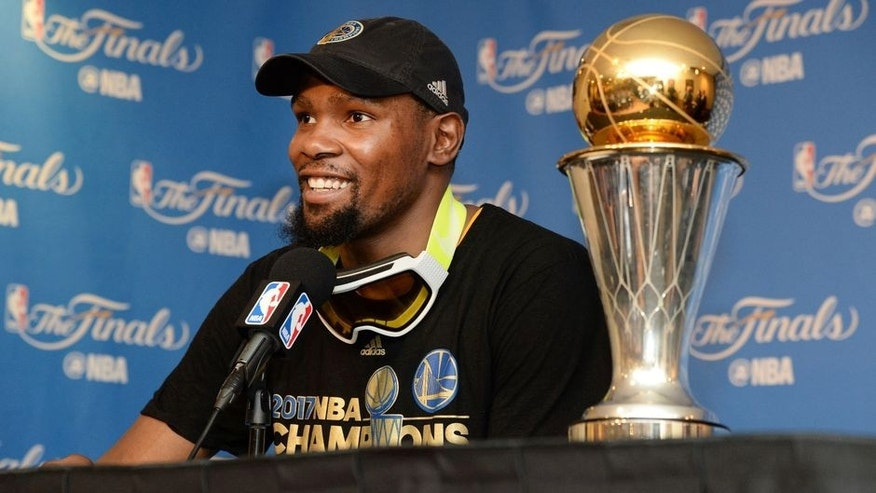 OAKLAND, CA - JUNE 12: NBA Finals MVP Kevin Durant #35 of the Golden State Warriors speaks to the media after winning the NBA Championship in Game Five of the 2017 NBA Finals against the Cleveland Cavaliers on June 12, 2017 at ORACLE Arena in Oakland, California. NOTE TO USER: User expressly acknowledges and agrees that, by downloading and/or using this photograph, user is consenting to the terms and conditions of Getty Images License Agreement. Mandatory Copyright Notice: Copyright 2017 NBAE (Photo by Andrew D. Bernstein/NBAE via Getty Images)