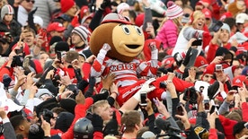 Nov 26, 2016; Columbus, OH, USA; Brutus Buckeye crowd surfs as fans surge onto the field following the win over the Michigan Wolverines at Ohio Stadium. Ohio State won 30-27. Mandatory Credit: Joe Maiorana-USA TODAY Sports - RTSTGQI