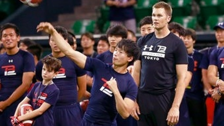 New England Patriots quarterback Tom Brady watches throwing practice during a football clinic in Tokyo, Wednesday, June 21, 2017. (AP Photo/Shizuo Kambayashi)