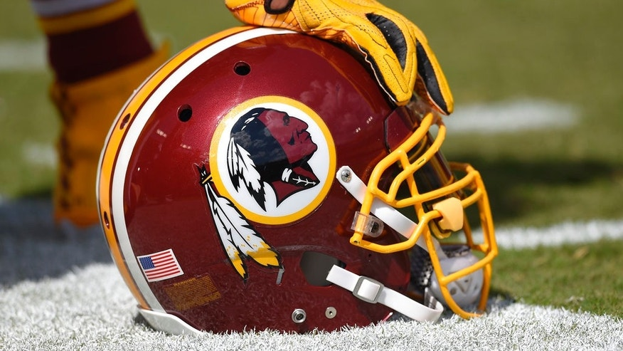 A Washington Redskins helmet on the sidelines.