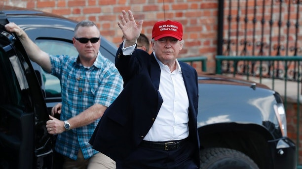 President Donald Trump arrives to enter his presidential viewing stand Saturday, July 15, 2017, during the U.S. Women's Open Golf tournament at Trump National Golf Club in Bedminster, N.J. (AP Photo/Carolyn Kaster)