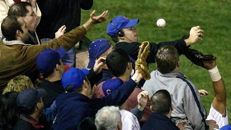 Steve Bartman, catches a ball as Chicago Cubs left fielder Moises Alou's arm is seen reaching into the stands, against the Florida Marlins in the eighth inning during Game 6 of the National League championship, Oct. 14, 2003.