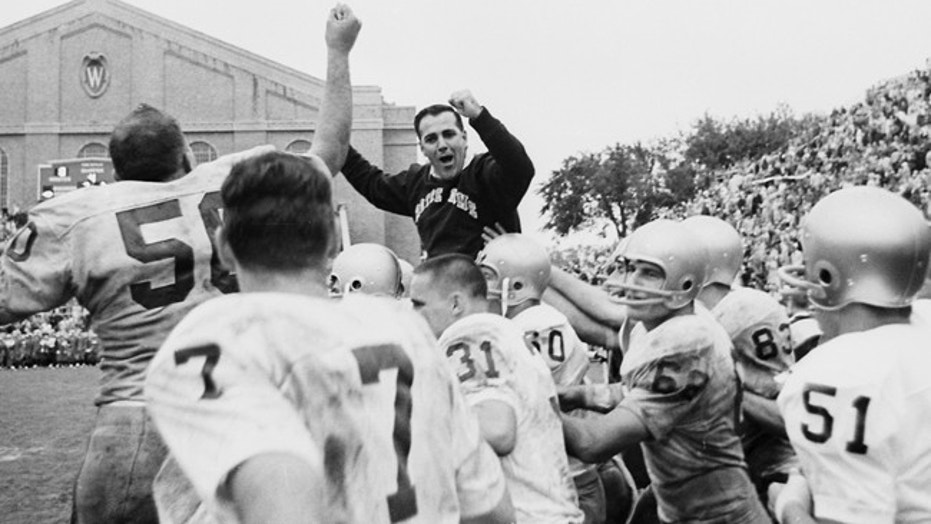 Notre Dame coach Ara Parseghian celebrates his first victory with the school on Sept. 26, 1964.