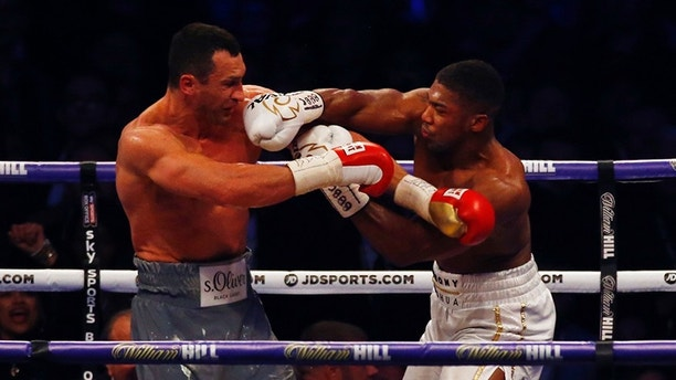 Britain Boxing - Anthony Joshua v Wladimir Klitschko IBF, IBO & WBA Super World Heavyweight Title's - Wembley Stadium, London, England - 29/4/17 Anthony Joshua in action with Wladimir Klitschko Action Images via Reuters / Peter Cziborra Livepic EDITORIAL USE ONLY. - RTS14HY1