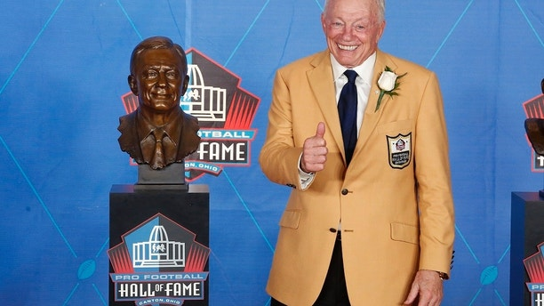 NFL team owner Jerry Jones poses with a bust of himself during an induction ceremony at the Pro Football Hall of Fame Saturday, Aug. 5, 2017, in Canton, Ohio. (AP Photo/Gene J. Puskar)