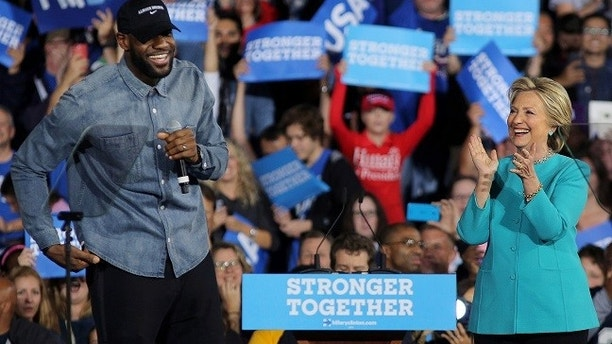 NBA basketball player Lebron James introduces U.S. Democratic presidential nominee Hillary Clinton during a campaign rally in Cleveland, Ohio, U.S., November 6, 2016. REUTERS/Carlos Barria - RTX2S7I0