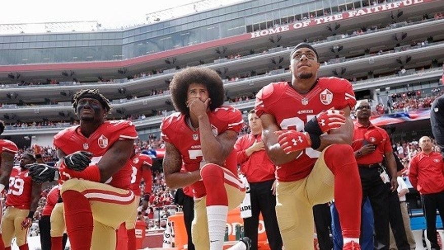 San Francisco 49ers outside linebacker Eli Harold, quarterback Colin Kaepernick, center, and safety Eric Reid kneel during the national anthem before the 49ers game against the Dallas Cowboys this past October 2.