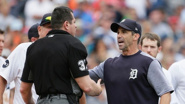 Detroit Tigers' Brad Ausmus, right, talks with home plate umpire Carlos Torres after Detroit's James McCann was hit by a pitch during the seventh inning of a baseball game against the New York Yankees on Thursday, Aug. 24, 2017, in Detroit. The Tigers won 10-6. (AP Photo/Duane Burleson)