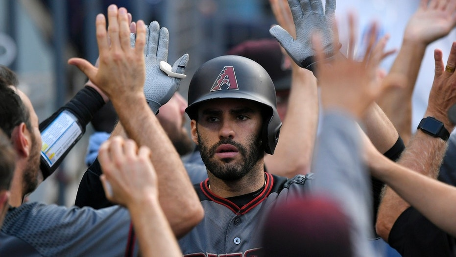 Sept. 4: Arizona Diamondbacks' J.D. Martinez is congratulated by teammates after hitting a two-run home run during the fourth inning of a baseball game against the Los Angeles Dodgers