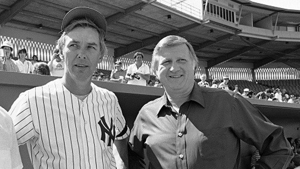 FILE - In this March 1, 1981, file photo, New York Yankees manager Gene Michael, left, and team owner George Steinbrenner are shown during a team workout in Fort Lauderdale, Fla. Gene Michael, the slick-fielding shortstop nicknamed Stick who went on to manage the Yankees and then as a front-office executive built a power than won four World Series titles in a five-year span, died Thursday, Sept. 7, 2017. He was 79. Michael had a heart attack, the Yankees said. (AP Photo/Kathy Willens, File)