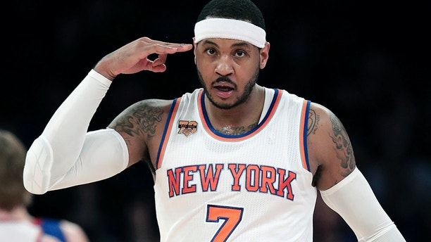 FILE - In this March 27, 2017, file photo, New York Knicks forward Carmelo Anthony (7) reacts after hitting a 3-point shot against the Detroit Pistons during the second quarter of an NBA basketball game in New York. The Knicks agreed to trade Anthony to the Thunder on Saturday, Sept. 23, 2017, saving themselves a potentially awkward reunion next week with the player they'd been trying to deal since last season.  New York will get Enes Kanter, Doug McDermott and a draft pick, a person with knowledge of the deal said. The person spoke with The Associated Press on condition of anonymity because the trade had not been announced.  (AP Photo/Julie Jacobson, File)