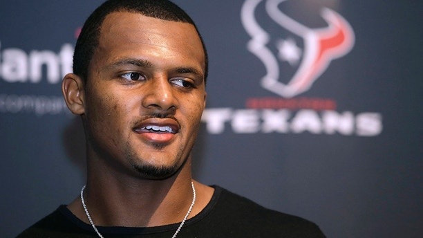 Houston Texans quarterback Deshaun Watson speaks to the media following an NFL football game against the New England Patriots, Sunday, Sept. 24, 2017, in Foxborough, Mass. (AP Photo/Steven Senne)