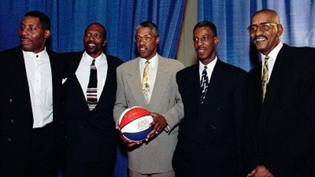 "FILE - In this Aug. 23, 1997, file photo, basketball players from left, Connie Hawkins, Marvin Barnes, Julius Erving, Charlie Scott and George Gervin pose for a photograph at the American Basketball Association 30th Reunion in Indianapolis. Basketball great Connie Hawkins has died at 75. The Hall of Famer's death was announced in a statement Saturday, Oct. 7, 2017,  by the Phoenix Suns, the team with which he spent his most productive NBA seasons. The Suns told The Associated Press they confirmed the death with his family. The 6-foot-8 Hawkins was a dazzling playground legend in New York City who rose to basketball's heights. The Suns lauded his ""unique combination of size, grace and athleticism.""(AP Photo/Tom Russo, File)"