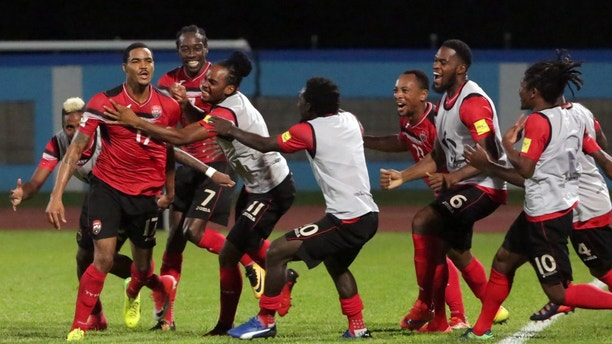 Soccer Football - 2018 World Cup Qualifications - North, Central America & Caribbean - Trinidad and Tobago v United States - Ato Boldon Stadium, Couva, Trinidad and Tobago - October 10, 2017 Trinidad's Alvin Jones celebrates his goal with team mates. REUTERS/Andrea de Silva - RC1F0C50B720