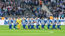 Players of Berlin kneel down prior to the German Bundesliga soccer match between Hertha BSC Berlin and FC Schalke 04 in Berlin, Germany, Saturday, Oct. 14, 2017. Hertha Berlin nodded to social struggles in the United States by kneeling before its Bundesliga game at home to Schalke on Saturday. Hertha's starting lineup linked arms and took a knee on the pitch.  The action was intended to show solidarity with NFL players who have been demonstrating against discrimination in the US by kneeling, sitting or locking arms through the anthem before games. (Annegret Hilse/dpa via AP)
