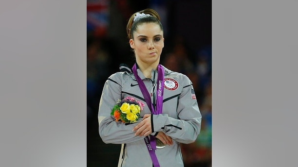 McKayla Maroney of the U.S. celebrates with her silver medal in the women's vault victory ceremony in the North Greenwich Arena during the London 2012 Olympic Games August 5, 2012.  REUTERS/Brian Snyder (BRITAIN  - Tags: SPORT OLYMPICS SPORT GYMNASTICS)   - LM2E8851CICTU